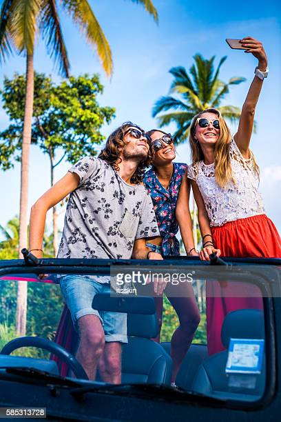 Friends traveling with 4x4 car in the jungle