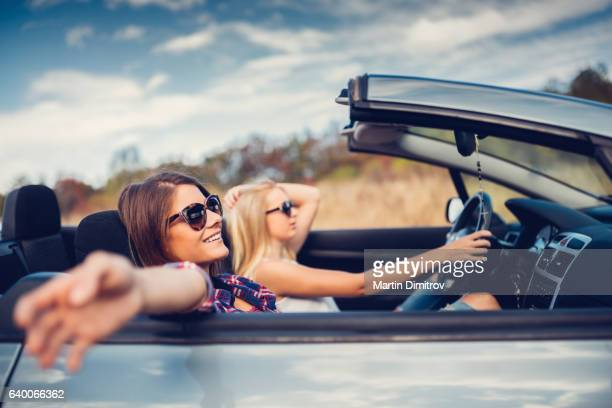 Friends traveling with car