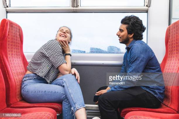 friends travelling by train on rainy day having fun, london, uk - heterosexual couple stock pictures, royalty-free photos & images
