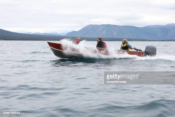 friends travelling on a boat in northern bc, canada - motorboat stock photos and pictures