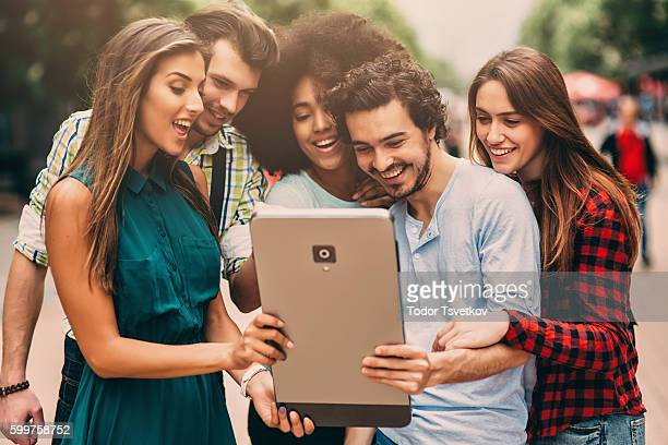 Friends using a large smart phone