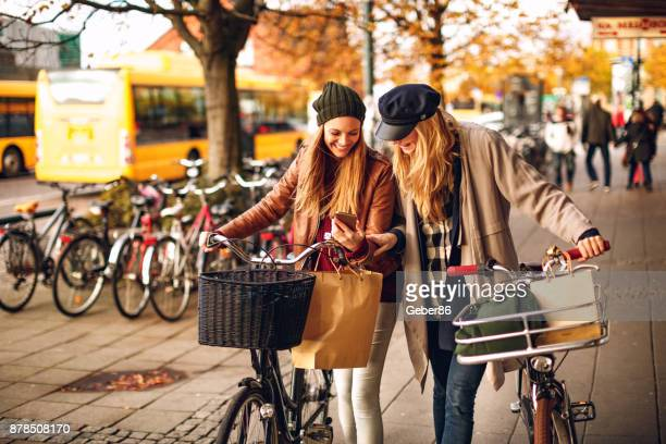 friends using a phone - sweden stock pictures, royalty-free photos & images