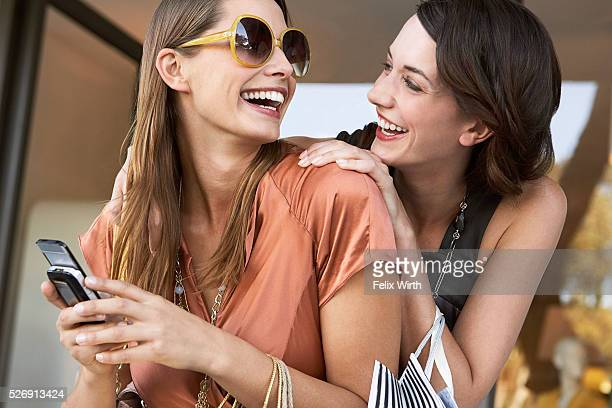 Friends using cell phone
