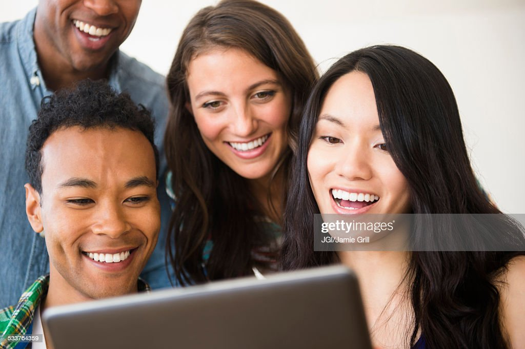 Friends using digital tablet together : Foto stock