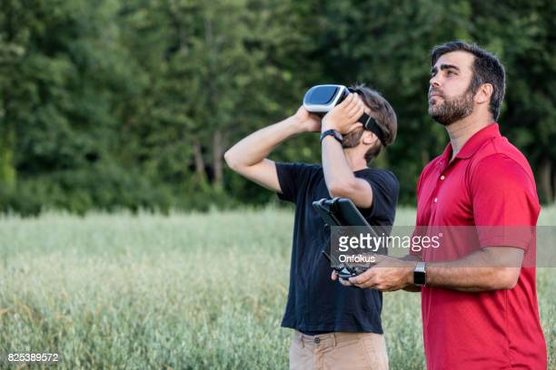 friends using drone and virtual reality headset outdoor - remote controlled stock photos and pictures