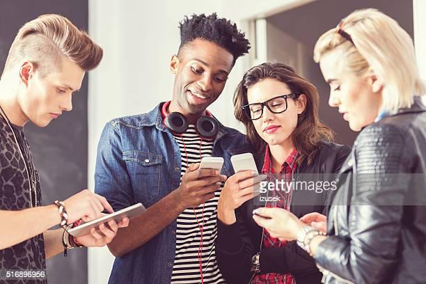 Friends using smart phones