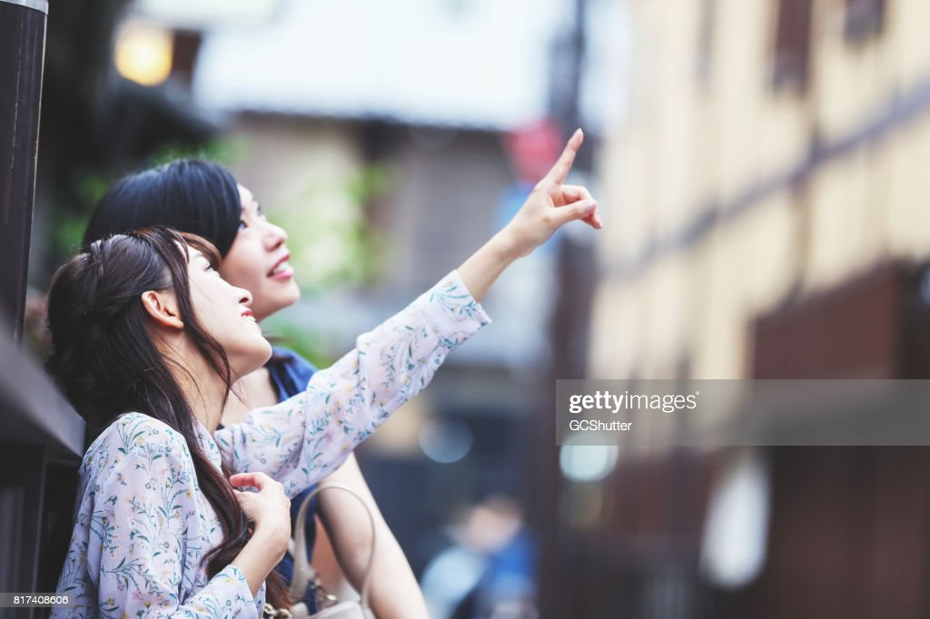 Friends visiting famous tourist destination in Kyoto, Japan : Stock Photo