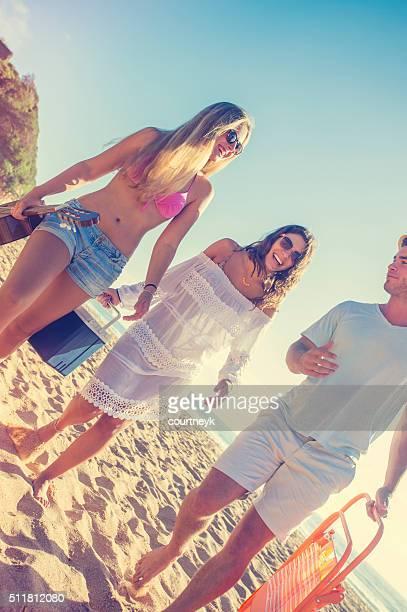 Friends walking along the beach