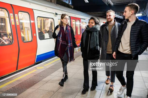 friends walking at subway station platfom - transportation stock pictures, royalty-free photos & images