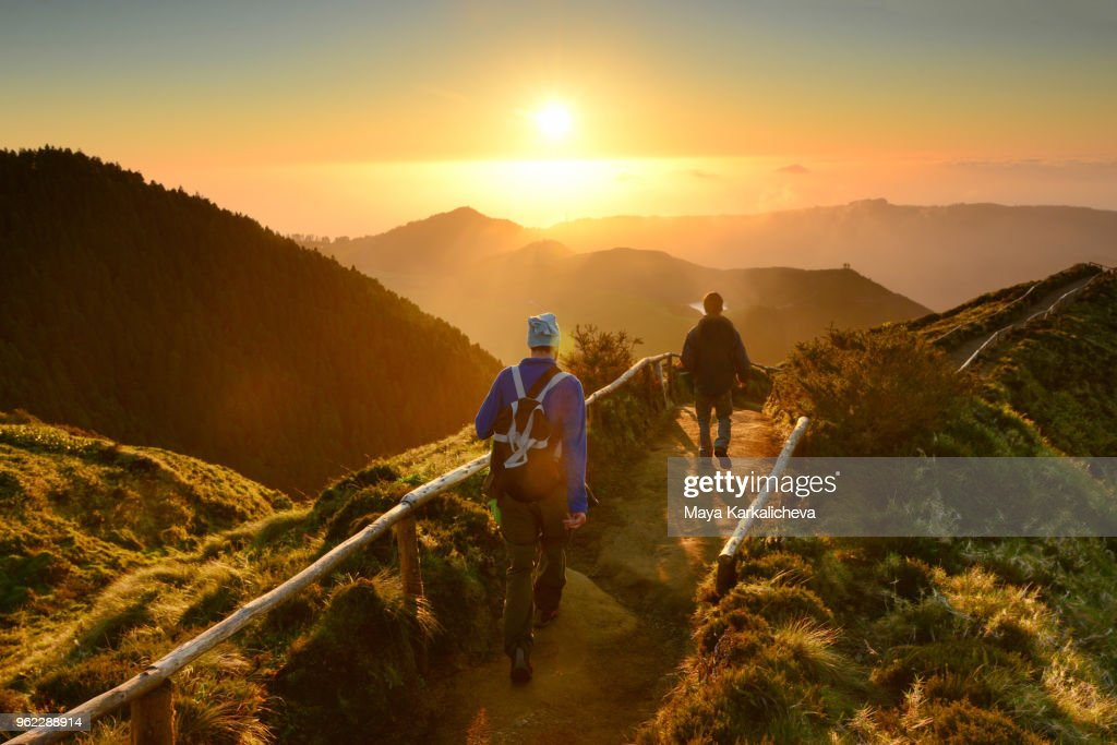 Friends walking at sunset at Sete Cidades lakes, Sao Miguel island, Azores, Atlantic ocean, Portugal : Stock Photo