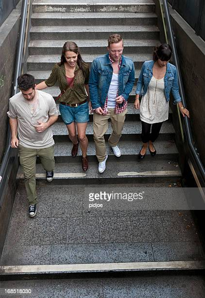 friends walking down the steps of subway station
