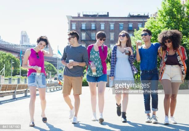 Friends walking in city street