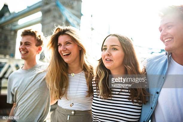 friends walking in london at tower bridge
