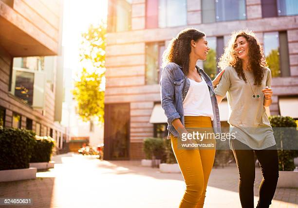 Friends Walking In Urban Area Together
