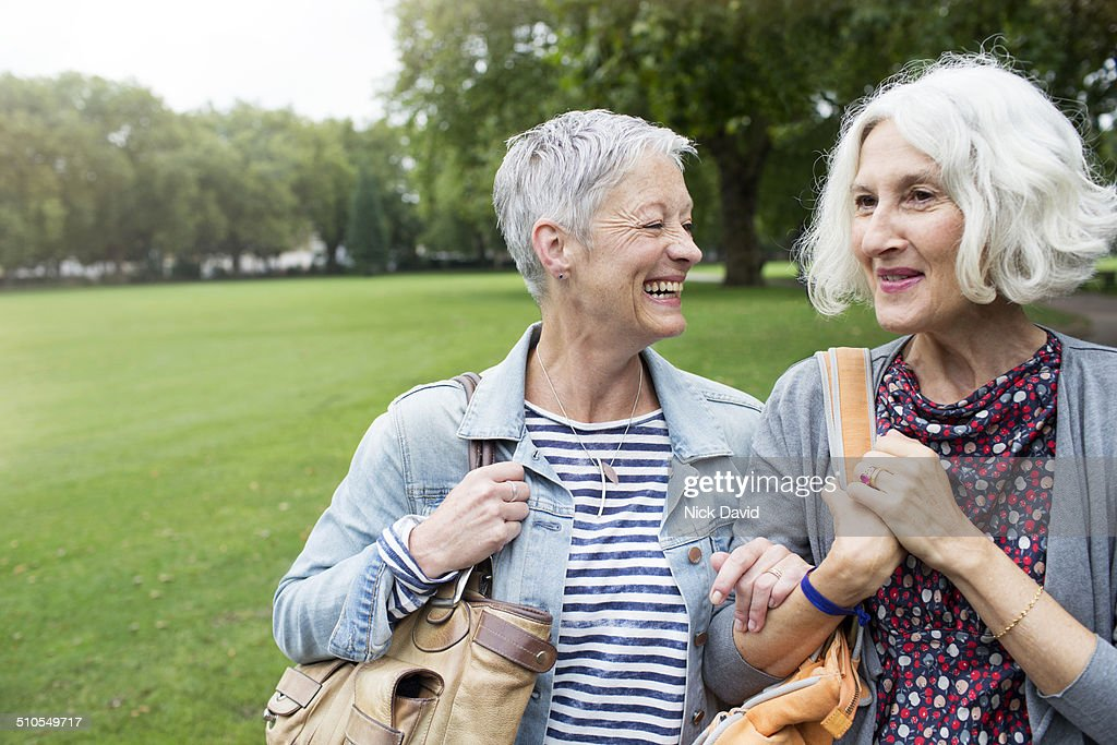 Friends walking & laughing together : Stock Photo