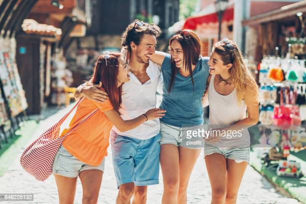 Friends walking on a shopping street and laughing