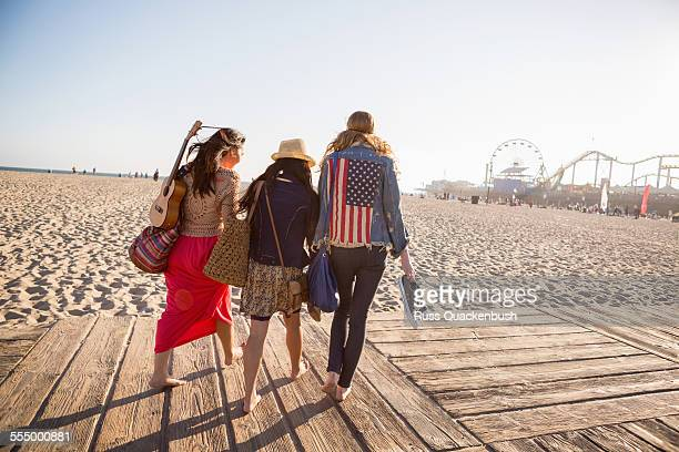 friends walking, santa monica pier, santa monica beach, us - santa monica stock pictures, royalty-free photos & images