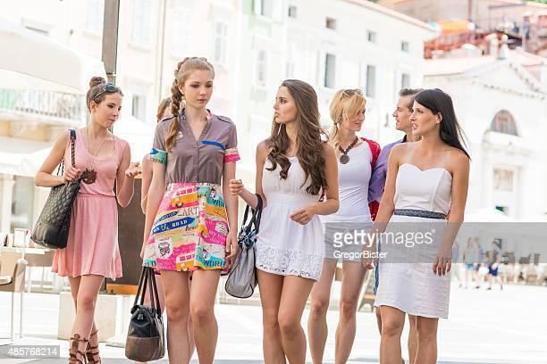 Friends walking through a city centre