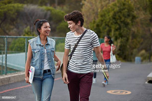 friends walking to school together & laughing - waistcoat stock photos and pictures