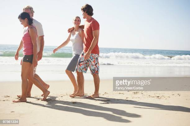 Friends Walking Together at the Beach