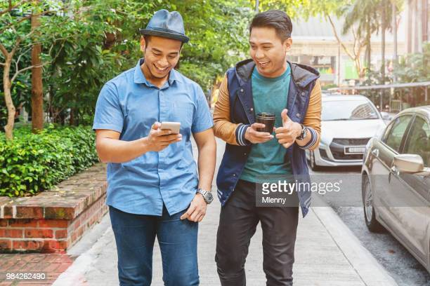 friends walking together in kuala lumpur malaysia - downtown comedy duo stock pictures, royalty-free photos & images