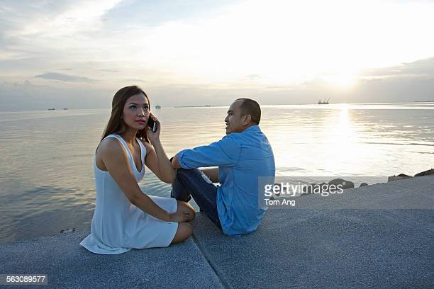 friends watch sunset at manila bay - manila bay stock photos and pictures