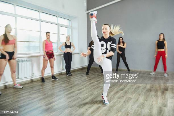 Friends watching at woman practicing at dance studio