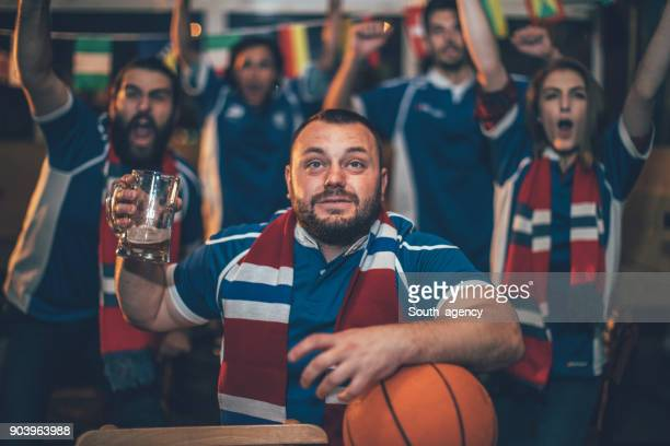 Friends watching basketball in the pub