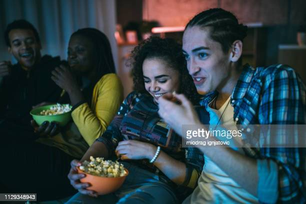 friends watching favorite television show - friends television show stock pictures, royalty-free photos & images