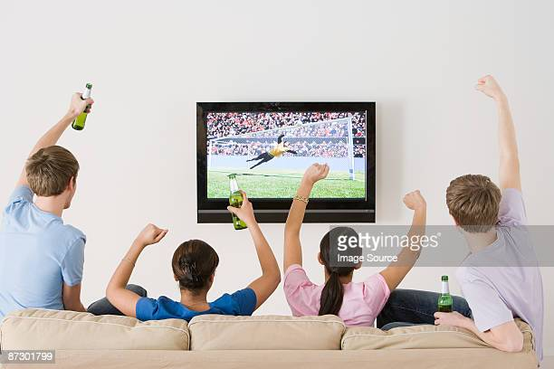 Friends watching football on the tv