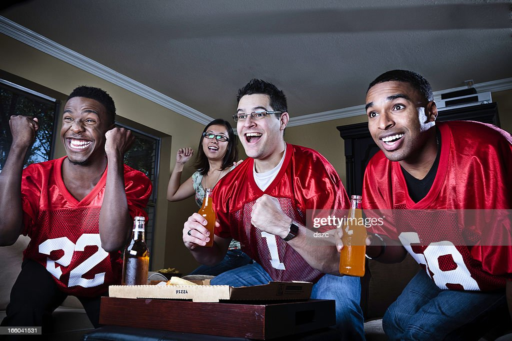 friends watching football on TV : Stock Photo
