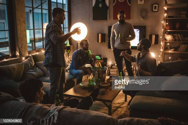 friends watching game on tv - man cave stock pictures, royalty-free photos & images