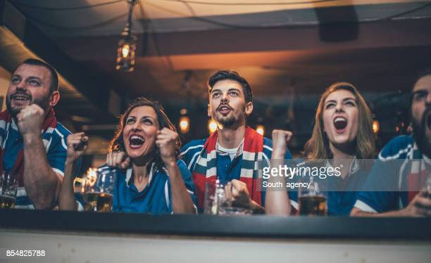 Friends watching game together in bar