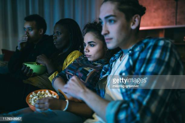 friends watching horror movie - horror movie stock pictures, royalty-free photos & images