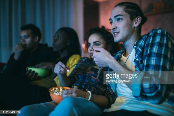 friends watching horror movie - horror movie stock photos and pictures