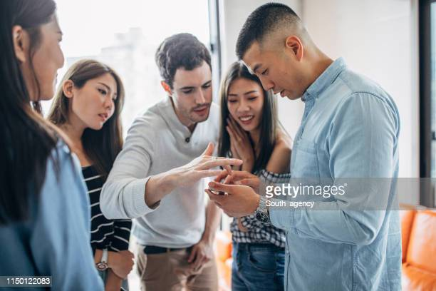 Friends watching mobile phones