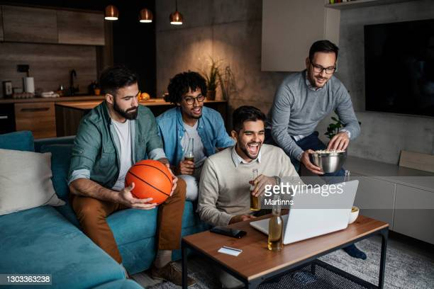 friends watching sport on lap top - final game stock pictures, royalty-free photos & images