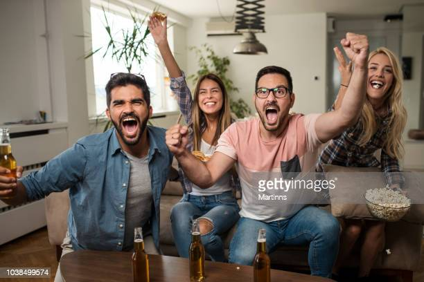 friends watching sport on tv. - sports league stock pictures, royalty-free photos & images