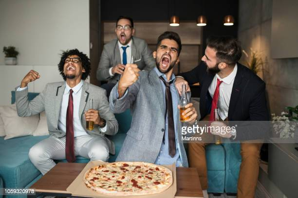 friends watching sport on tv. - final game stock pictures, royalty-free photos & images
