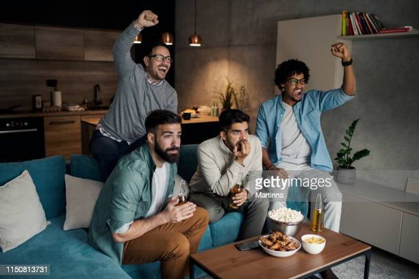friends watching sport on tv. - match sport stock pictures, royalty-free photos & images