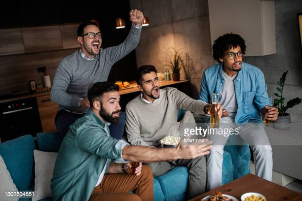 friends watching sport on tv - final game stock pictures, royalty-free photos & images