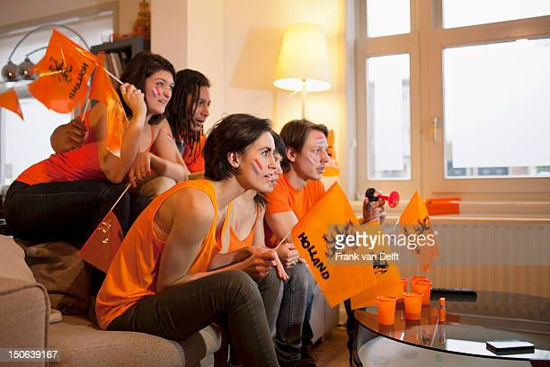 friends watching sports on television - fan stockfoto's en -beelden
