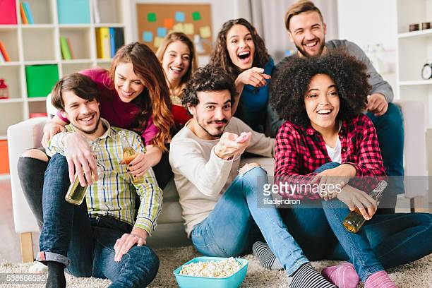 friends watching tv - glee tv show stock photos and pictures
