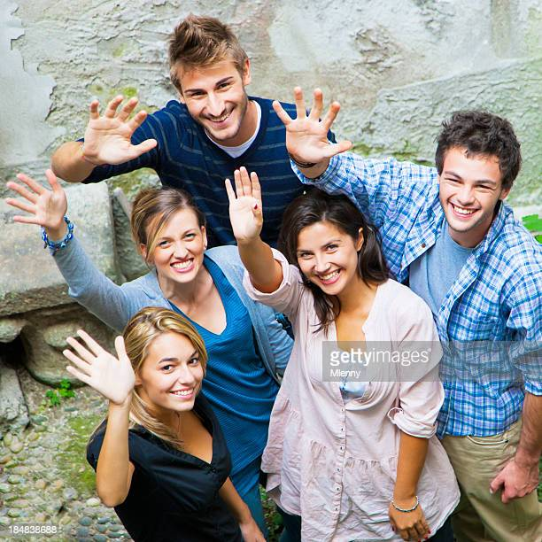 Friends waving hands together to welcome