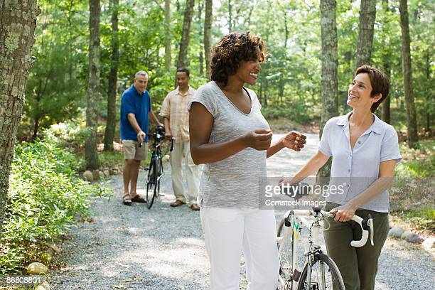 Friends with bicycles in park