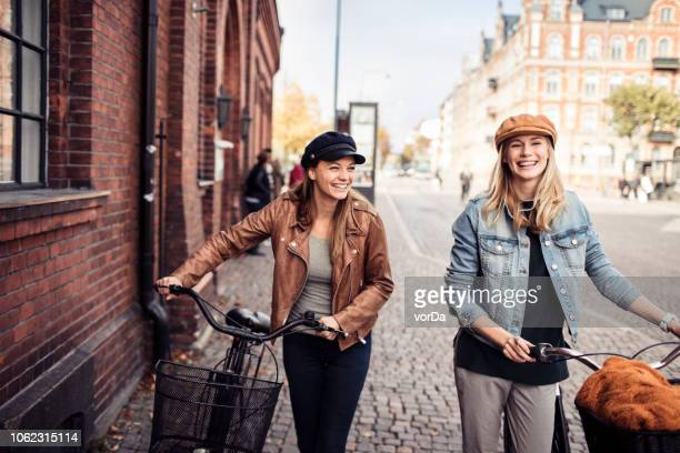 friends with bicycles - city life stock pictures, royalty-free photos & images