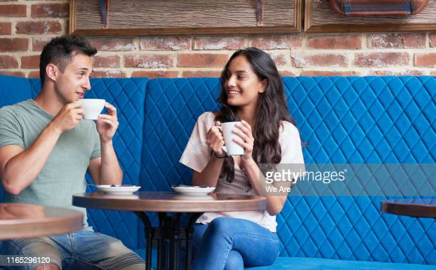 friends with coffee in cafe - daten stockfoto's en -beelden