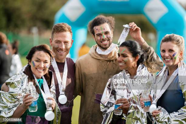 friends with medals after stampede race - medallist stock pictures, royalty-free photos & images