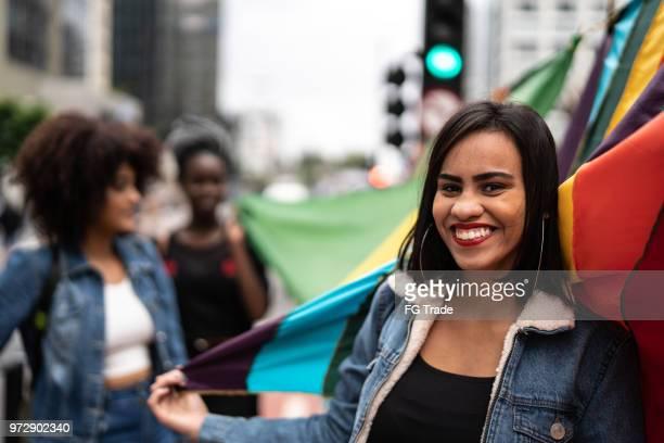 friends with rainbow flag at gay parade, avenida paulista, sao paulo, brazil - preconceito racial imagens e fotografias de stock