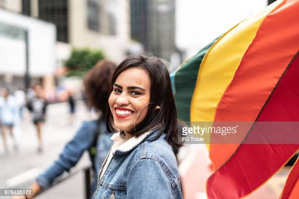 friends with rainbow flag at gay parade, avenida paulista, sao paulo, brazil - pride stock pictures, royalty-free photos & images